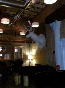 """Huge """"deer head"""" on wall."""