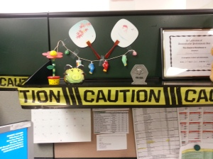 Caution tape and a scary mask for my piggy bank