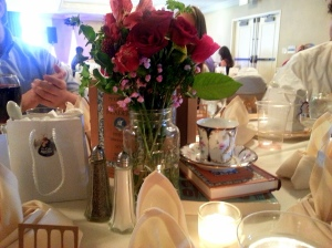 There were flowers and books as the centerpieces. So whimsical, loved it.
