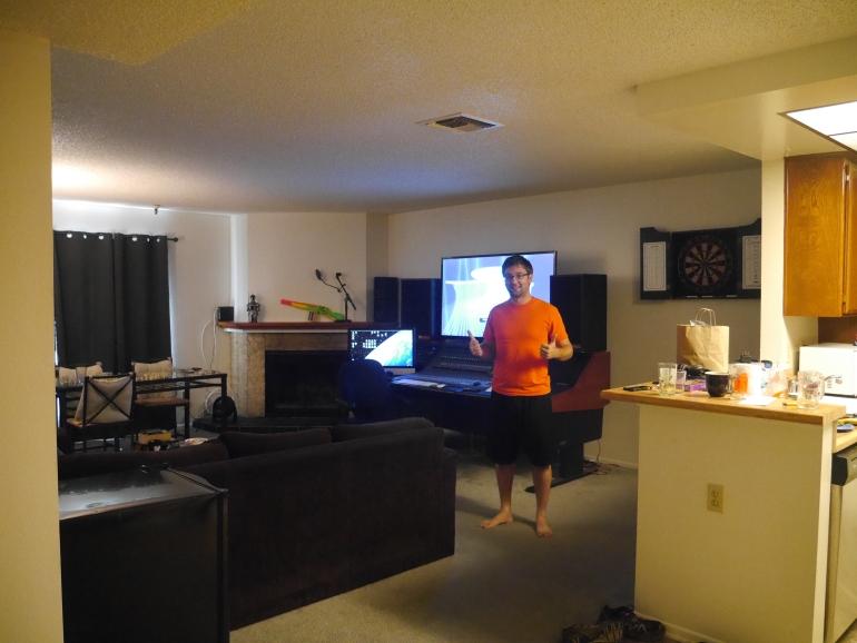 Sean showing off his spacious apartment.
