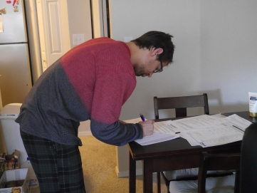 Gene signing some pre-approval mortgage paperwork
